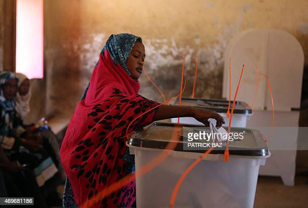 A Sudanese woman casts her vote in the country's elections at a polling station in a classroom in Khartoum's southern suburb of Mayo on April 14 2015...