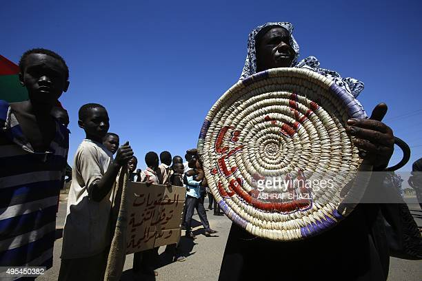 A Sudanese woman demonstrates outside the US embassy in the capital Khartoum on November 3 to protest against sanctions imposed on their country by...