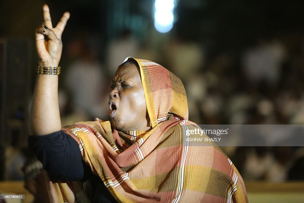 A Sudanese woman flashes the Vsign for victory as members of Sudan's opposition parties armed groups and civil society groups attend late on February...