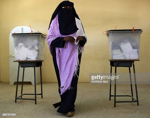 A Sudanese woman prepares to cast her vote at a polling station in Khartoum on April 15 2015 Sudanese are voting in elections boycotted by the...