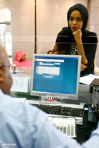A Sudanese woman waits at a foreign exchange dealer in central Khartoum on October 12 after the lifting of the US trade embargo came into effect...