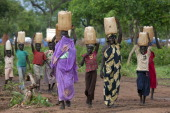 Sudanese women and children carry water at the Yida refugee camp along the border with North Sudan June 30 2012 in Yida South Sudan Water has been a...