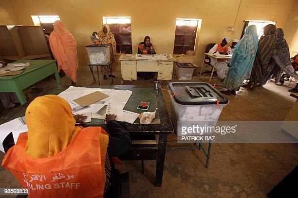 Sudanese women cast their votes at a polling station in Hosh Bannaga the hometown of ruling President Omar alBeshir on April 12 2010 Voting proceeded...