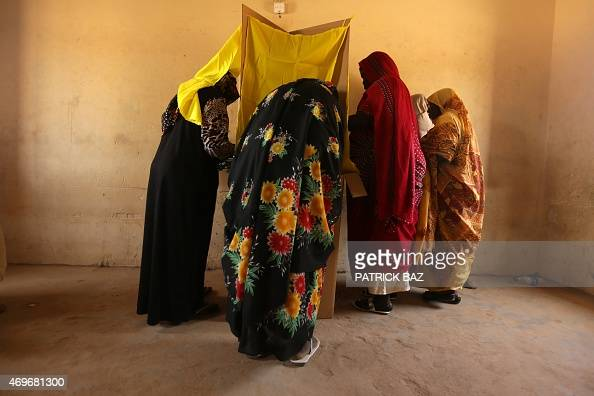 Sudanese women prepare to cast their votes in the country's elections at a polling station in a classroom in Khartoum's southern suburb of Mayo on...