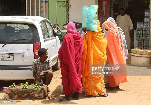 Sudanese women shop at a market in Shendi the hometown of President Omar alBashir located on the banks of the Nile in Sudan's Arab heartland 190...