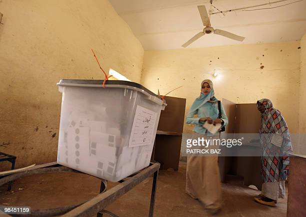 Sudanese women walk towards a ballot box to cast their votes at a polling station in Khartoum on April 14 2010 Sudanese President Omar alBeshir's...