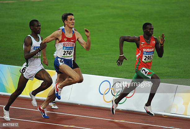 Sudan's Abubaker Kaki Russia's Dmitry Bogdanov and Saudi Arabia's Mohammed alSalhi compete during the men's 800m round 1 heat 2 at the National...