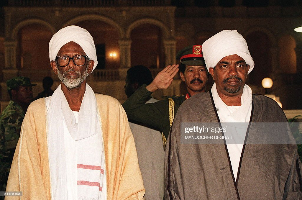 Sudan's Islamic leader, Moslem cleric and parliamentaryu speaker <a gi-track='captionPersonalityLinkClicked' href=/galleries/search?phrase=Hassan+al-Turabi&family=editorial&specificpeople=590997 ng-click='$event.stopPropagation()'>Hassan al-Turabi</a> (l) and Sudanese President General Omar el-Bashir (r) shown in a picture dated 02 December 1993 in Khartum at the opening of an Arab-Islamic conference.