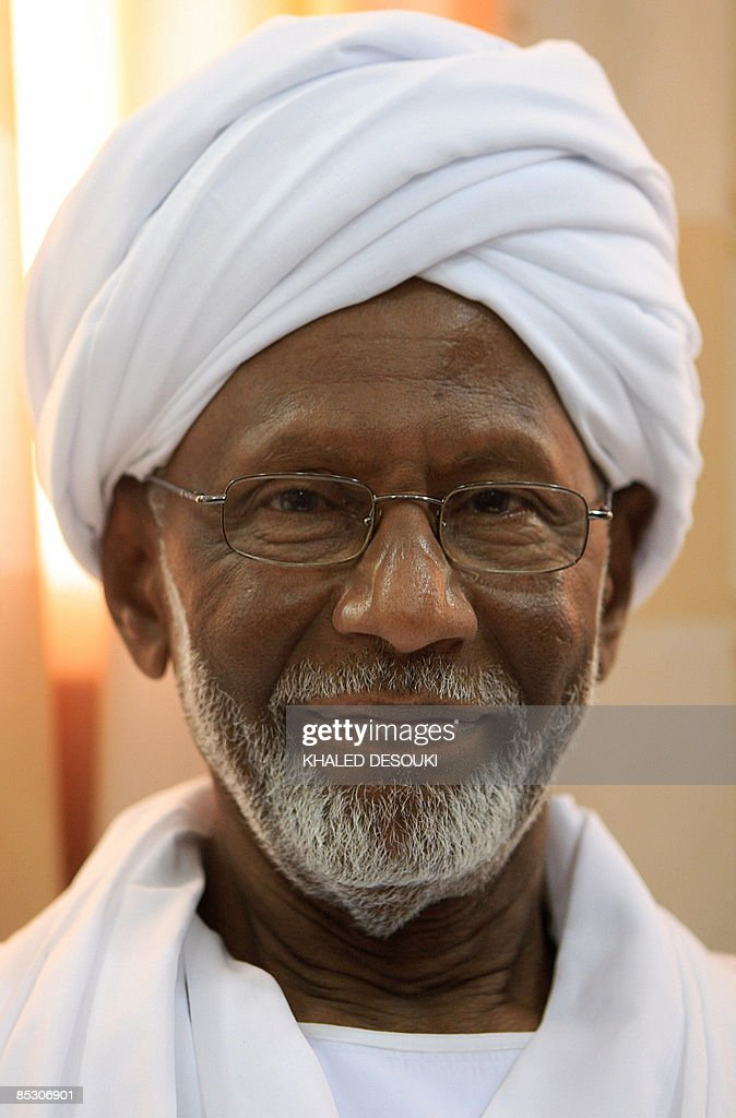 Sudan's Islamist opposition leader <a gi-track='captionPersonalityLinkClicked' href=/galleries/search?phrase=Hassan+al-Turabi&family=editorial&specificpeople=590997 ng-click='$event.stopPropagation()'>Hassan al-Turabi</a> smiles at his home following his release from jail in Khartoum on March 9, 2009. Turabi, a fierce critic of the regime who has been in and out of jail over a career spanning about four decades, was detained in January after calling for President Omar al-Beshir to surrender to the International Criminal Court.