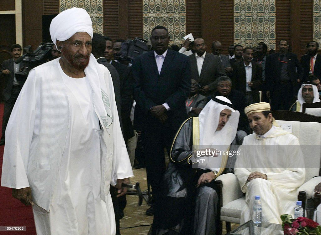 Sudan's leader of the Umma Party, opposition figure Sadiq al-Mahdi (L), arrives to listen to a speech by President Omar al-Bashir on January 27, 2014 in which he appealed for a political and economic renaissance in his country ravaged by war, poverty and political turmoil, in the Sudanese capital Khartoum. It was the latest call Bashir has made in the past year for a broad political dialogue, including with the country's armed insurgents. But this time, he made his appeal directly to opposition figures -- including breakaway members of his own party -- who joined the audience of government-linked parties, cabinet members and foreign diplomats for his speech.