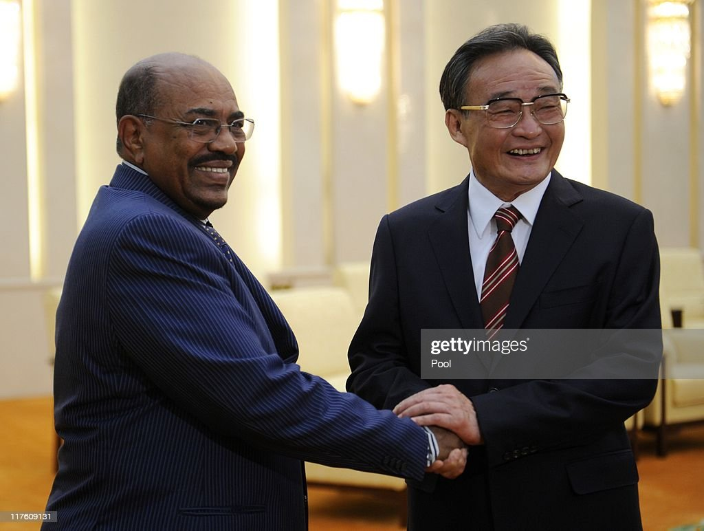 Sudan's leader Omar al-Bashir (L) shakes hands with China's Chairman of the Standing Committee of the National People's Congress <a gi-track='captionPersonalityLinkClicked' href=/galleries/search?phrase=Wu+Bangguo&family=editorial&specificpeople=604934 ng-click='$event.stopPropagation()'>Wu Bangguo</a> (R) during their meeting at the Great Hall of the People in Beijing on June 29, 2011 in Beijing, China. Omar al-Bashir, who is wanted by the International Criminal Court for alleged war crimes, is on a four-day visit to China.