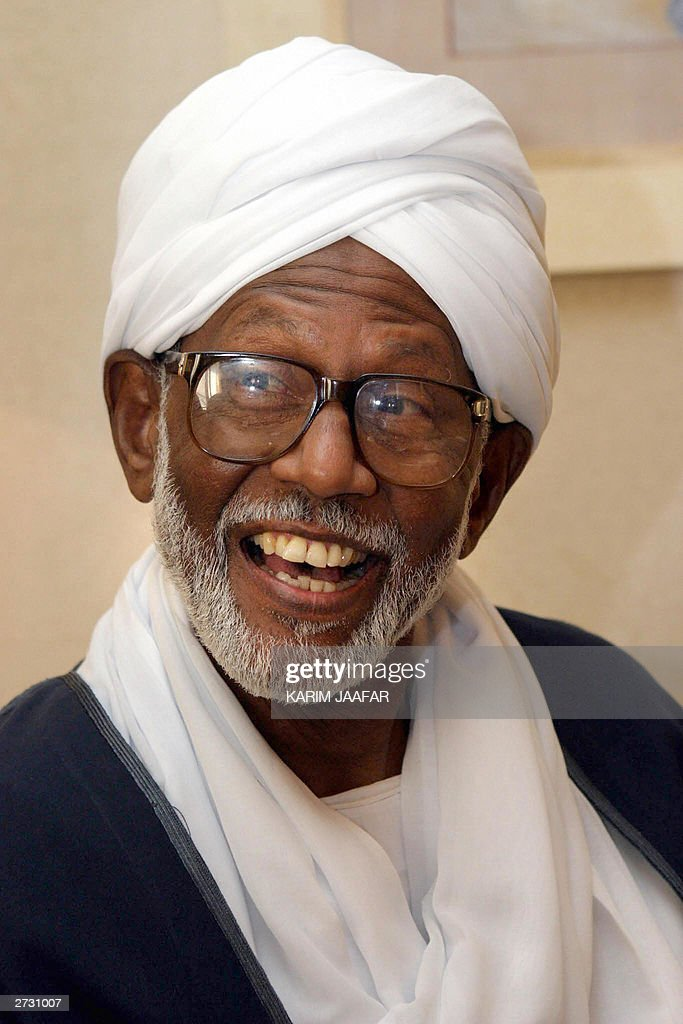 Sudan's opposition Islamist leader <a gi-track='captionPersonalityLinkClicked' href=/galleries/search?phrase=Hassan+al-Turabi&family=editorial&specificpeople=590997 ng-click='$event.stopPropagation()'>Hassan al-Turabi</a> talks to the press 15 November 2003 in Doha, where he is to take part in an Arab television program, a month after he was released from nearly three years of house arrest. Turabi backed the 1989 military coup which brought President Omar el-Beshir to power but was removed from key political posts after losing a power struggle with Beshir in 1999. AFP PHOTO/Karim JAAFAR