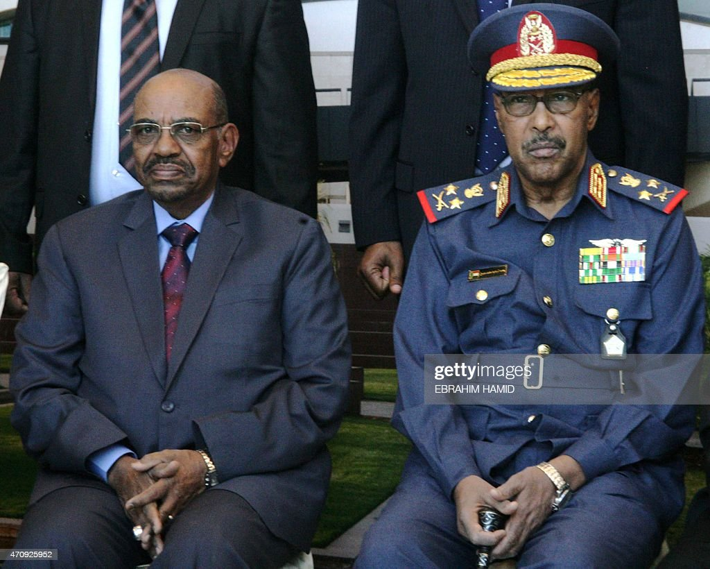 Sudan's President Omar al-Bashir (L) sits next to his Defence Minister Abdelrahim Mohammed Hussein during a meeting of representatives from east African defence ministries in the capital Khartoum on April 24, 2015. Bashir labelled foreign critics of last week's general elections, which he is widely expected to win, as 'colonialist parties' and said they would have no effect on the polls.