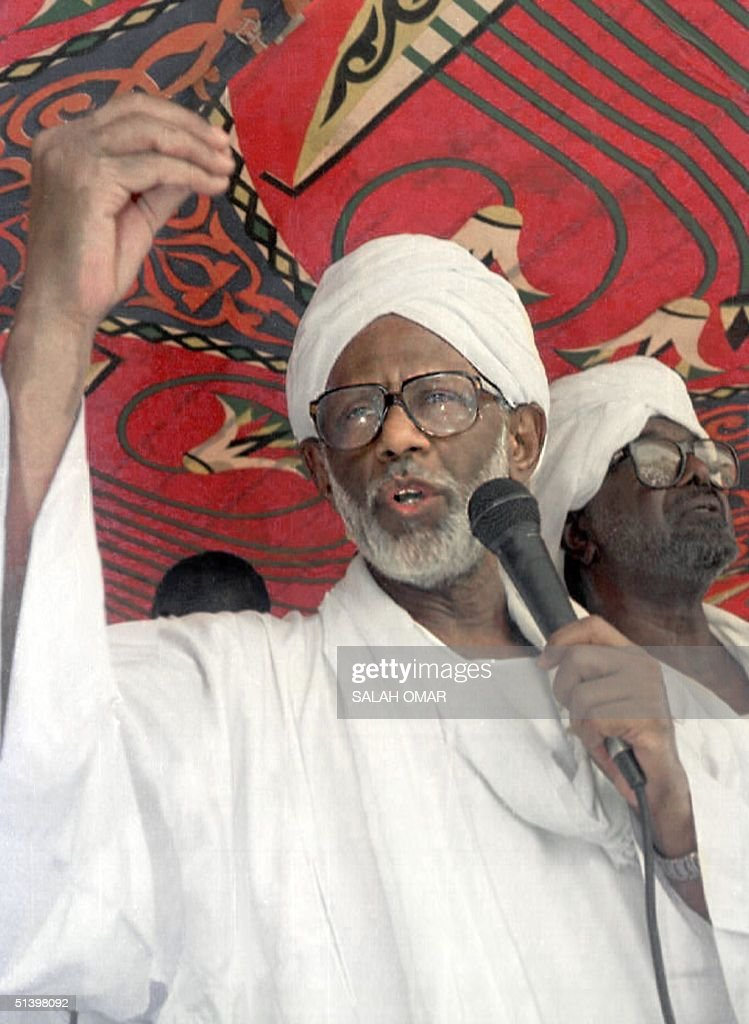 Sudan's veteran Islamist ideologue <a gi-track='captionPersonalityLinkClicked' href=/galleries/search?phrase=Hassan+al-Turabi&family=editorial&specificpeople=590997 ng-click='$event.stopPropagation()'>Hassan al-Turabi</a> addresses the public during a meeting with his follower in his Khartoum home 07 May 2000. Turabi accused President Omar al-Beshir of betraying the Islamist movement and vowed not to go quietly after being suspended as a leader of the ruling National Congress (NC) party. Beshir froze the former parliament speaker's position as NC secretary general 06 May after accusing Turabi of plotting to overthrow the government.