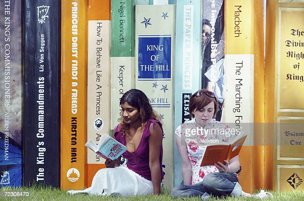 Sue Amaradivakara and Sarah Ross sit reading in front of some giant books at 'The Guardian Hay Festival 2004' held at Hay on Wye on May 30 2004 in...