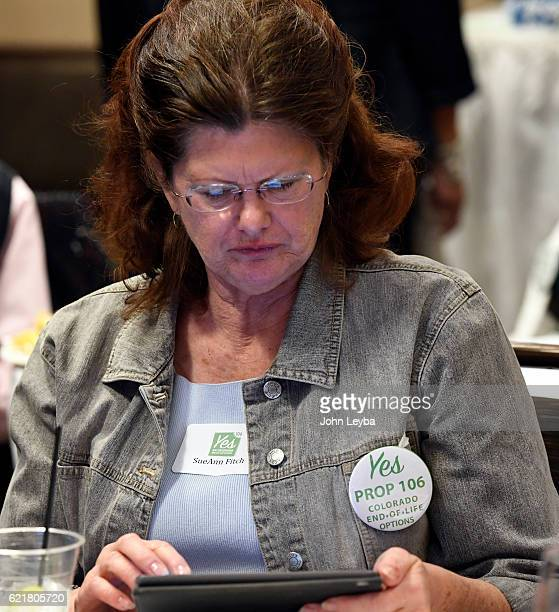 Sue Ann Fitch checks her iPad for early returns on Prop 106 a measure that would allow terminally ill patients to take lifeending doctorprescribed...