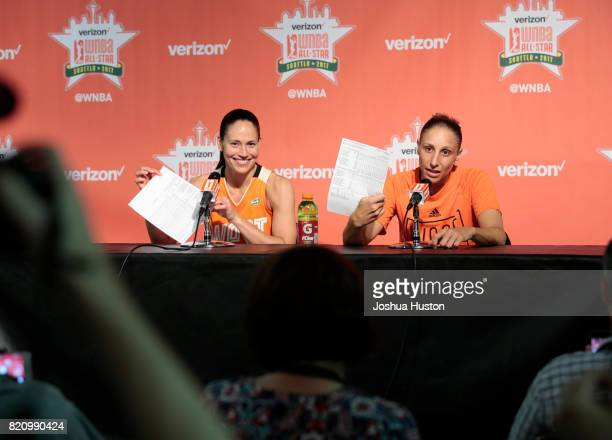 Sue Bird and Diana Taurasi of the Western Conference AllStars hold up stats sheets during a postgame press conference after the Verizon WNBA AllStar...