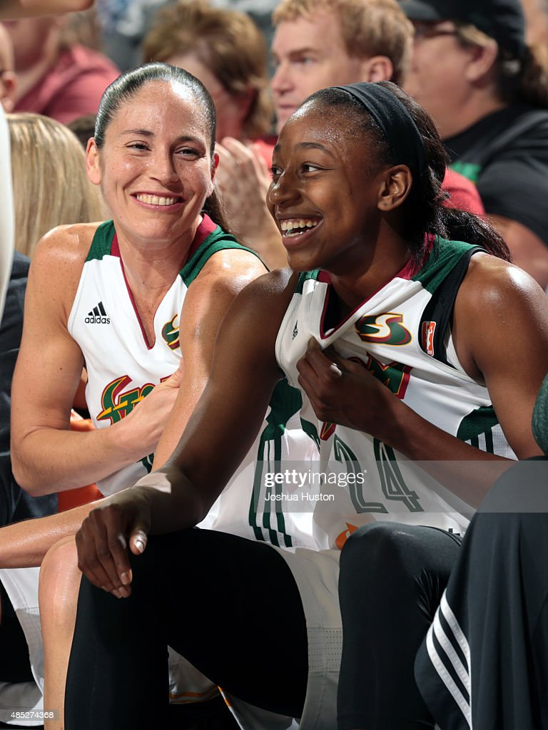 Sue Bird #10 and Jewell Loyd #24 of the Seattle Storm share a laugh during a game against the Indiana Fever on August 21, 2015 at Key Arena in Seattle, Washington.