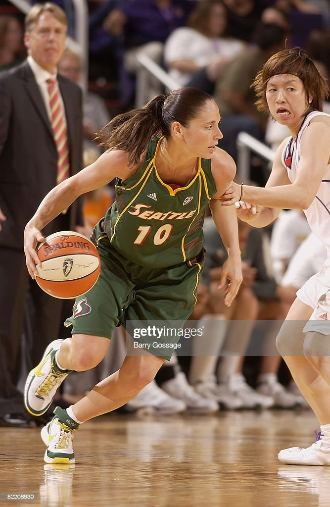 Sue Bird of the Seattle Storm drives the ball against Yuko Oga of the Phoenix Mercury during the WNBA game on July 25 2008 at US Airways Center in...
