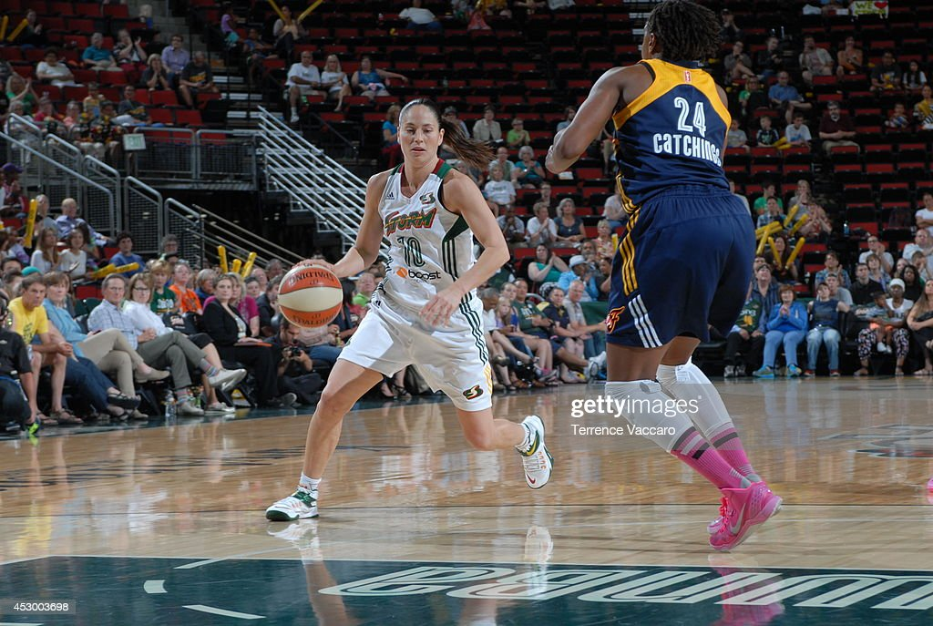 <a gi-track='captionPersonalityLinkClicked' href=/galleries/search?phrase=Sue+Bird&family=editorial&specificpeople=201535 ng-click='$event.stopPropagation()'>Sue Bird</a> #10 of the Seattle Storm drives to the basket against the Indiana Fever on July 31,2014 at Key Arena in Seattle, Washington.