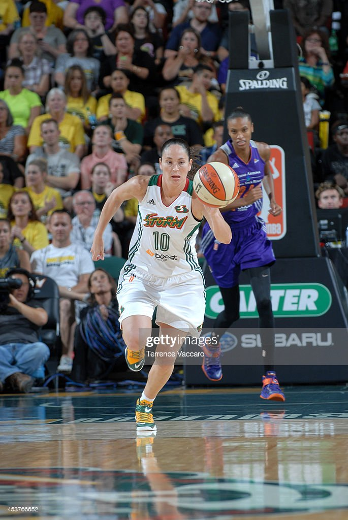 <a gi-track='captionPersonalityLinkClicked' href=/galleries/search?phrase=Sue+Bird&family=editorial&specificpeople=201535 ng-click='$event.stopPropagation()'>Sue Bird</a> #10 of the Seattle Storm handles the ball against the Phoenix Mercury during the game on August 17, 2014 at Key Arena in Seattle, Washington.