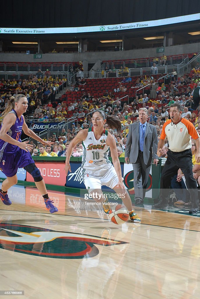 Sue Bird #10 of the Seattle Storm looks drives against Penny Taylor #13 of the Phoenix Mercury during the game on August 17, 2014 at Key Arena in Seattle, Washington.
