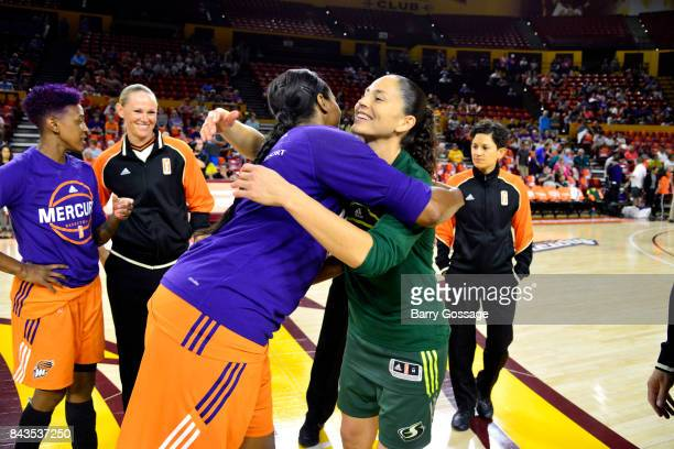 Sue Bird of the Seattle Storm shares a hug with Camille Little of the Phoenix Mercury before the game in Round One of the 2017 WNBA Playoffs on...
