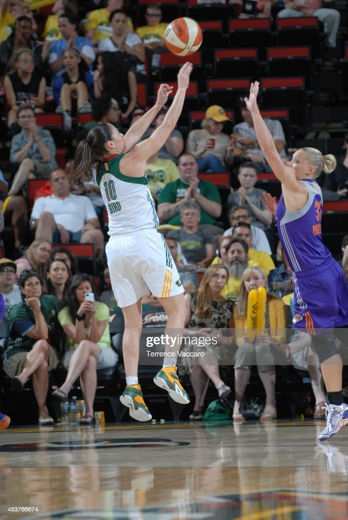 Sue Bird #10 of the Seattle Storm shoots the ball against Erin Phillips #31 of the Phoenix Mercury during the game on August 17, 2014 at Key Arena in Seattle, Washington.