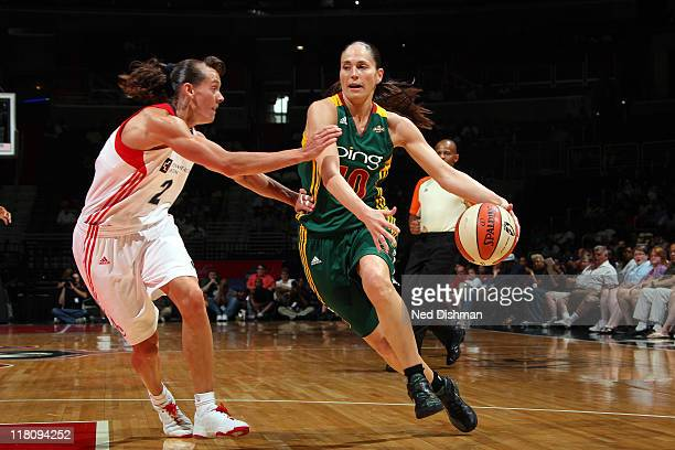 Sue Bird of the Washington Mystics drives against Kelly Miller of the Seattle Storm at the Verizon Center on July 3 2011 in Washington DC NOTE TO...