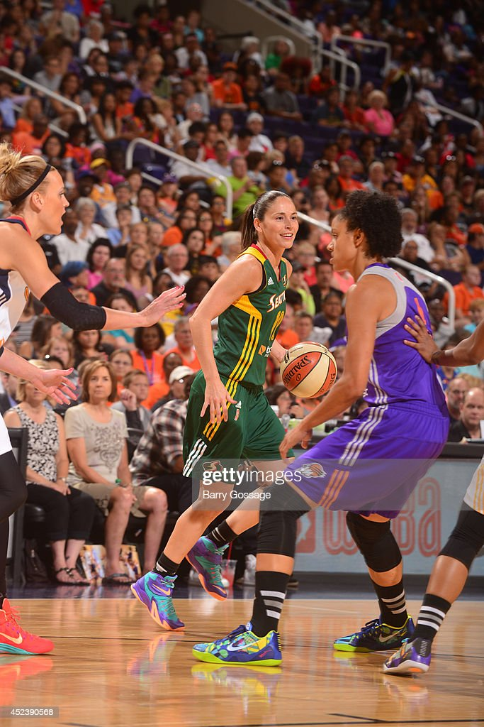 Sue Bird of the Western Conference AllStars dribbles against Katie Douglas of the Eastern Conference AllStars during the 2014 Boost Mobile WNBA...