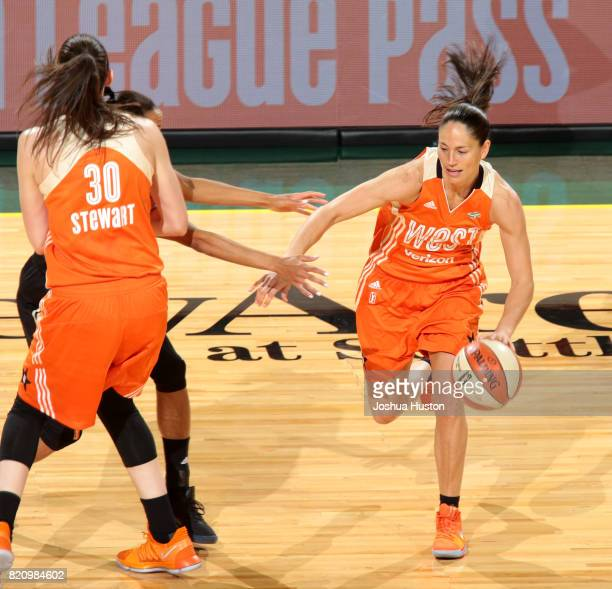 Sue Bird of the Western Conference AllStars dribbles upcourt while Breanna Stewart defends during the Verizon WNBA AllStar Game 2017 at KeyArena on...