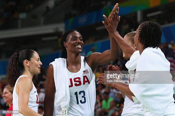 Sue Bird Sylvia Fowles and Tamika Catchings of United States celebrate after winning the Women's Gold Medal Game between United States and Spain on...