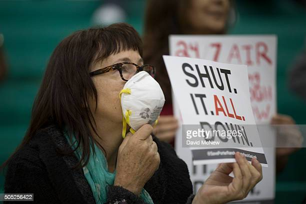 Sue Francis holds a sign while attending a public hearing before the South Coast Air Quality Management District regarding a proposed stipulated...