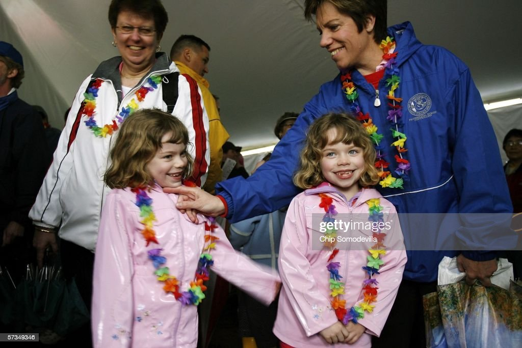 Sue Hollenshead and her partner Lori Collins wait with their twin daughters Lexi Collins and Allyson Collins to attend the annual White House Easter...