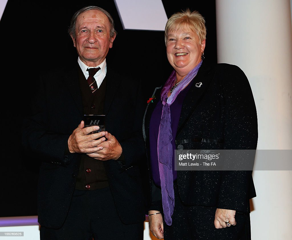 Sue Hough presents Trevor Clifton with the 'Special Achievement Award' during the FA Women's Awards 2012 at the Waldorf Hilton on November 2, 2012 in London, England.