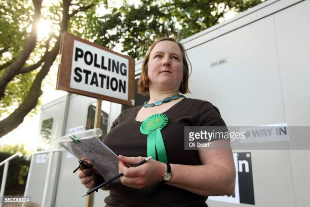 Sue Luxton a campaigner for the Green Party records voters' polling card numbers in Greenwich on June 4 2009 in London England The Green party is...