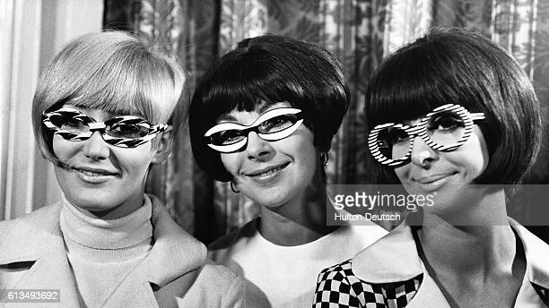 Sue Marshall and Christine and Kathie Harris model blackandwhite patterned frames at a show staged by the Optical Information Council at the Park...