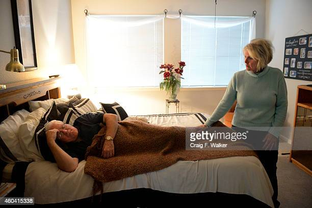 Sue Pelletier checks on her husband Tom as he rests at their home in Brighton CO October 01 2014 Tom has been diagnosed with both severe anxiety and...