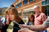 Sue Petrone Daniel Rohrbough's mother wipes away tears while talking to reporters after viewing a multimedia report by the El Paso County Sheriff's...