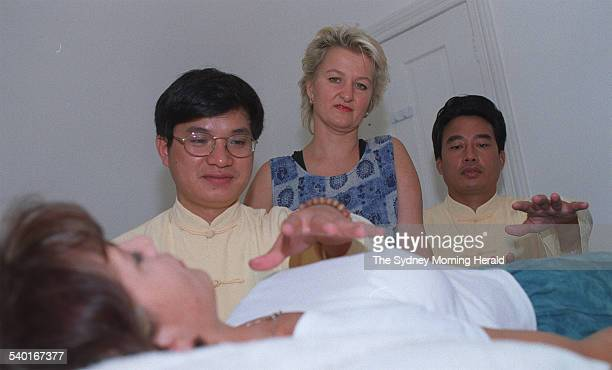 Sue PietersHawke with healers Robert Peng left and Zhao Shihua who are treating a patient suffering from chronic fatigue syndrome 13 February 1998...