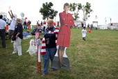 Sue Stevens carries a carboard cutout of former Alaska governor Sarah Palin during the Tea Party of America's 'Restoring America' event at the...