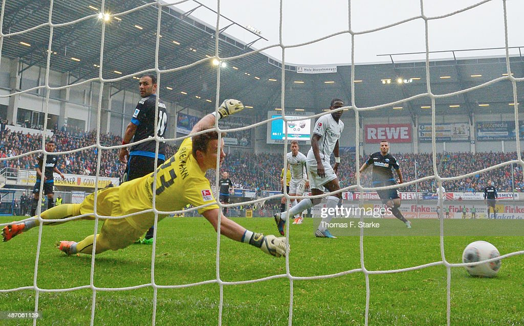 Sueleyman Koc (R) of Paderborn scores his teams first goal against <a gi-track='captionPersonalityLinkClicked' href=/galleries/search?phrase=Manuel+Riemann&family=editorial&specificpeople=4447812 ng-click='$event.stopPropagation()'>Manuel Riemann</a> (2nd L) of Sandhausen during the Second Bundesliga match between SC Paderborn and SV Sandhausen at Benteler Arena on April 27, 2014 in Paderborn, Germany.