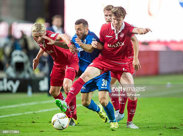 Sueleyman Koc of SC Paderborn challenges Tim Heuerbach of 1 FC Kaiserslautern and Patrick Ziegler of 1 FC Kaiserslautern during the second Bundesliga...