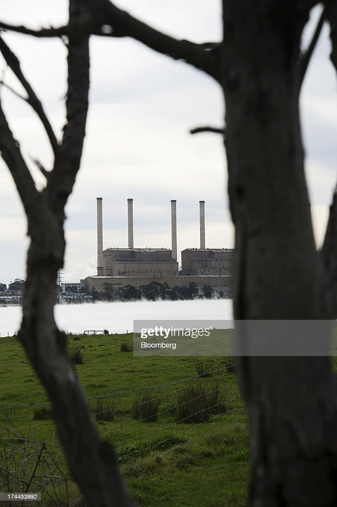 GDF Suez Australian Energy's Hazelwood coal-fired power station stands behind the facility's pondage in Morwell, Australia, on Thursday, July 25, 2013. Australian Prime Minister Kevin Rudd will cut spending and limit tax concessions to fund a move to emissions trading a year ahead of schedule, should his Labor government win this year's election. Photographer: Carla Gottgens/Bloomberg via Getty Images