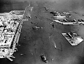 Suez Crisis Aerial view of the blocked Suez Canal at Port Said the sunken ships upper structures jutting out of the water as naval vessels work on...