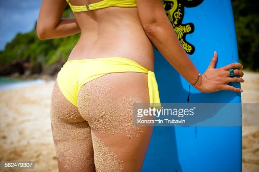 Sufer girl on the beach.