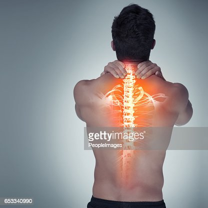 Suffering from tight and tense back pain : Stock-Foto