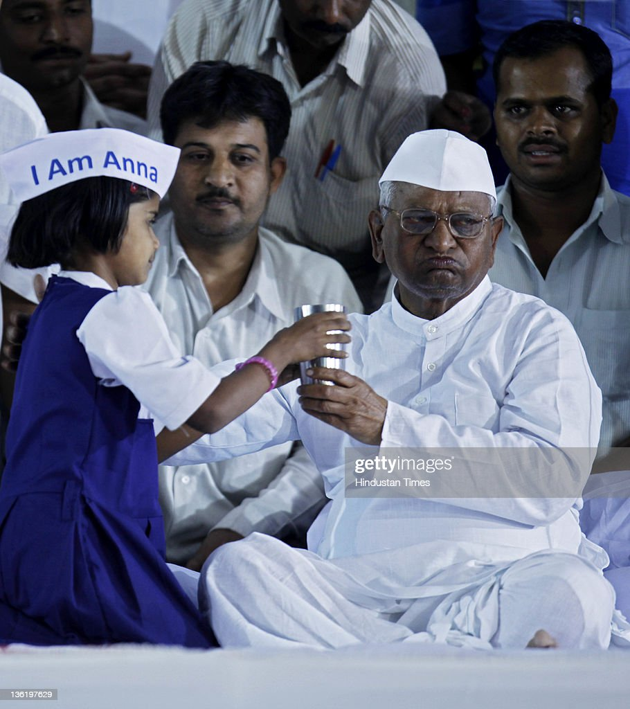 Suffering from viral fever <a gi-track='captionPersonalityLinkClicked' href=/galleries/search?phrase=Anna+Hazare&family=editorial&specificpeople=5963003 ng-click='$event.stopPropagation()'>Anna Hazare</a> breaks his fast with a glass of juice offered by a girl on the 2nd day of his 3-day Hunger Strike at MMRDA Ground, Bandra December 28, 2011 in Mumbai, India. Hazare was urged by doctors and supporters to break his fast as his health was deteriorating. He has also called off his nationwide 'Jail Filling' campaign which was scheduled from December 30, but declared that he will continue his fight and will campaign against congress in upcoming assembly polls.