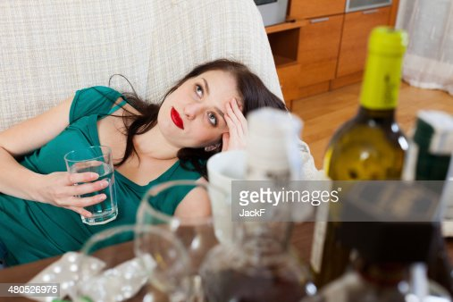 Suffering woman with glass of water : Stockfoto