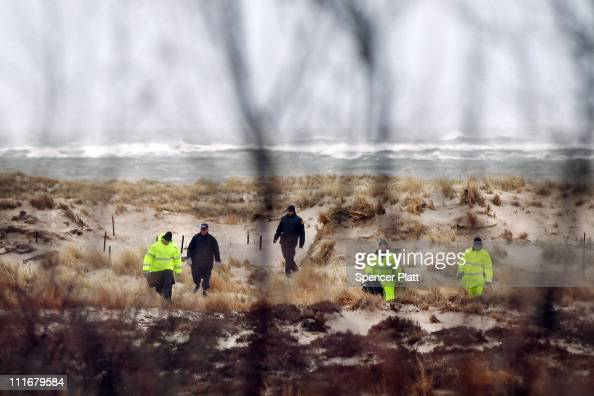 Suffolk County Police and police recruits search an area of beach near where police recently found human remains on April 5 2011 in Babylon New York...